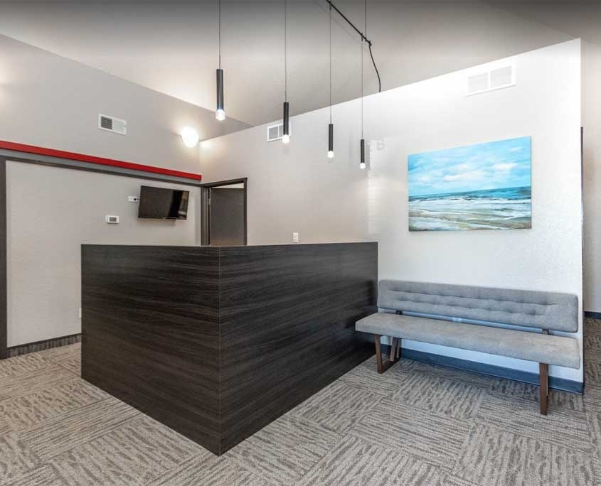 indoor view of advanced family eye care waterloo eye doctor office. modern looking office with a receptionist desk and waiting chair